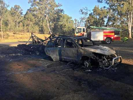 The burned out remains of a car and caravan which caught fire at Kybong.