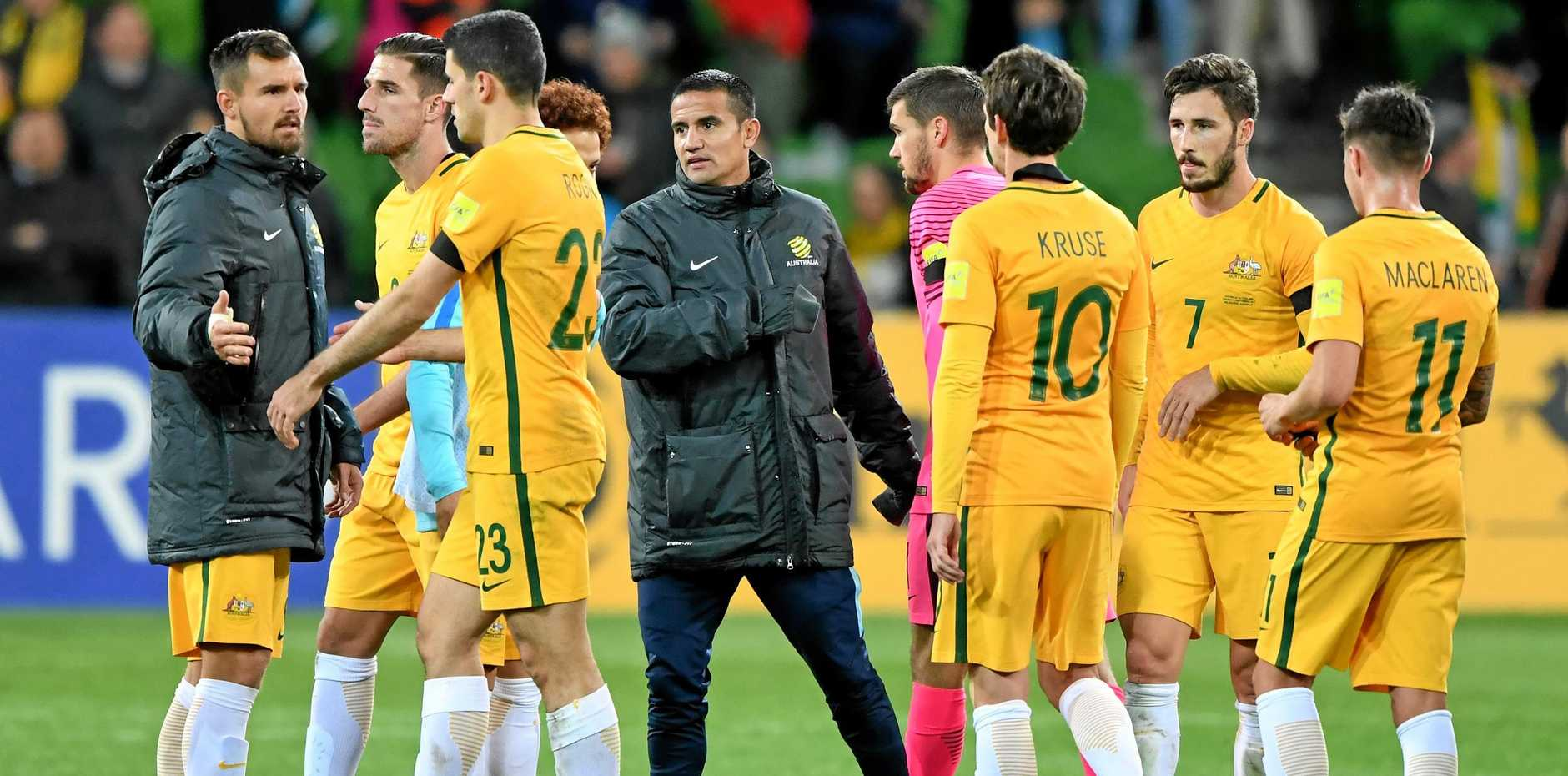 The Socceroos will play Syria in a two-legged playoff next month.
