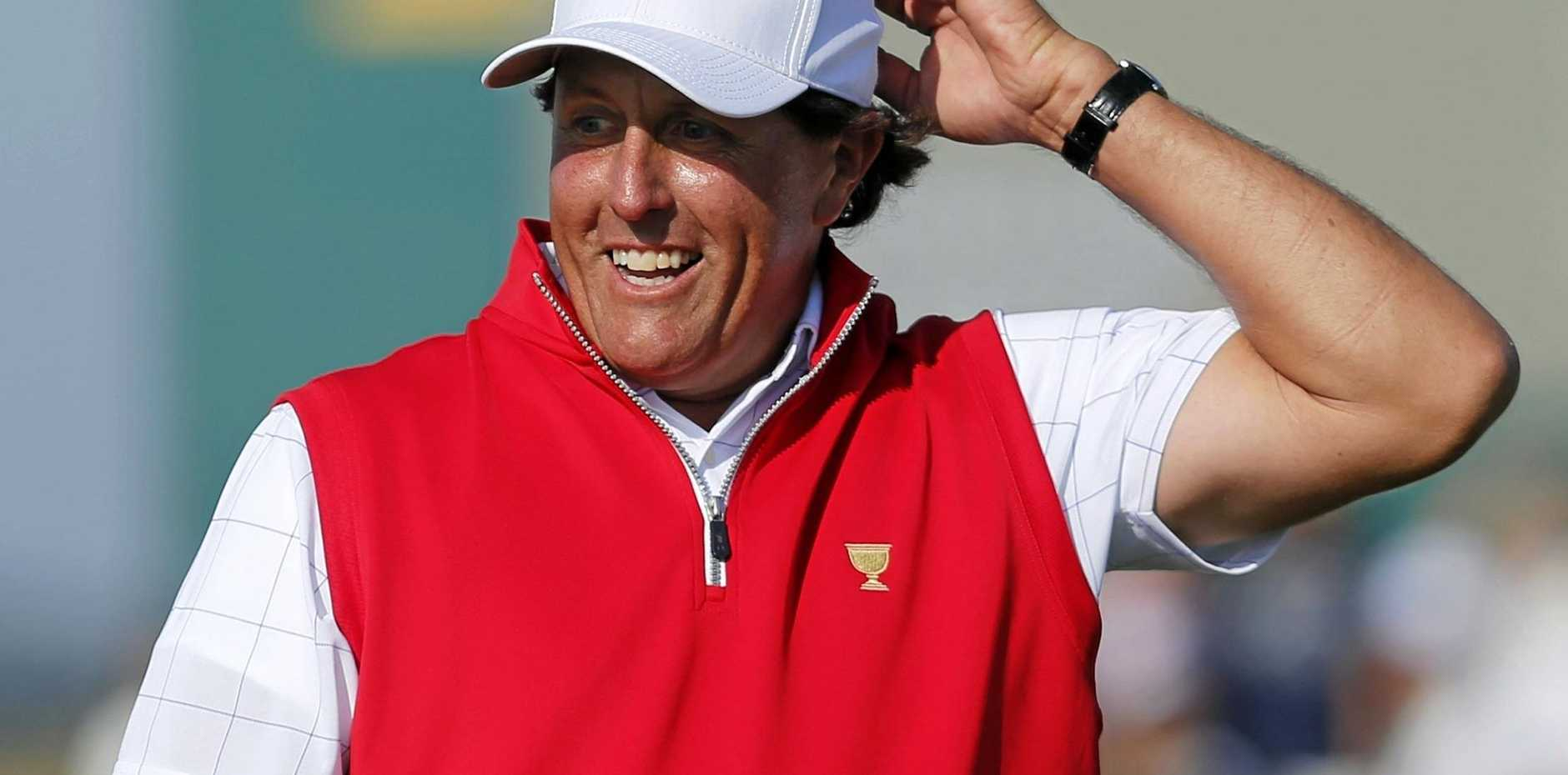Phil Mickelson reacts to a putt on the 17th green at the 2015 Presidents Cup in Korea.