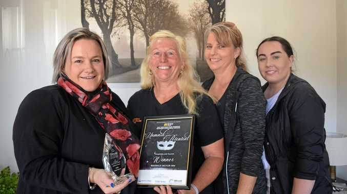 KEEP SMILING: A very happy Warwick Motor Inn crew, Shannon Atfield, Sue Hoffman, Angela Doran and Natalya McConnell.