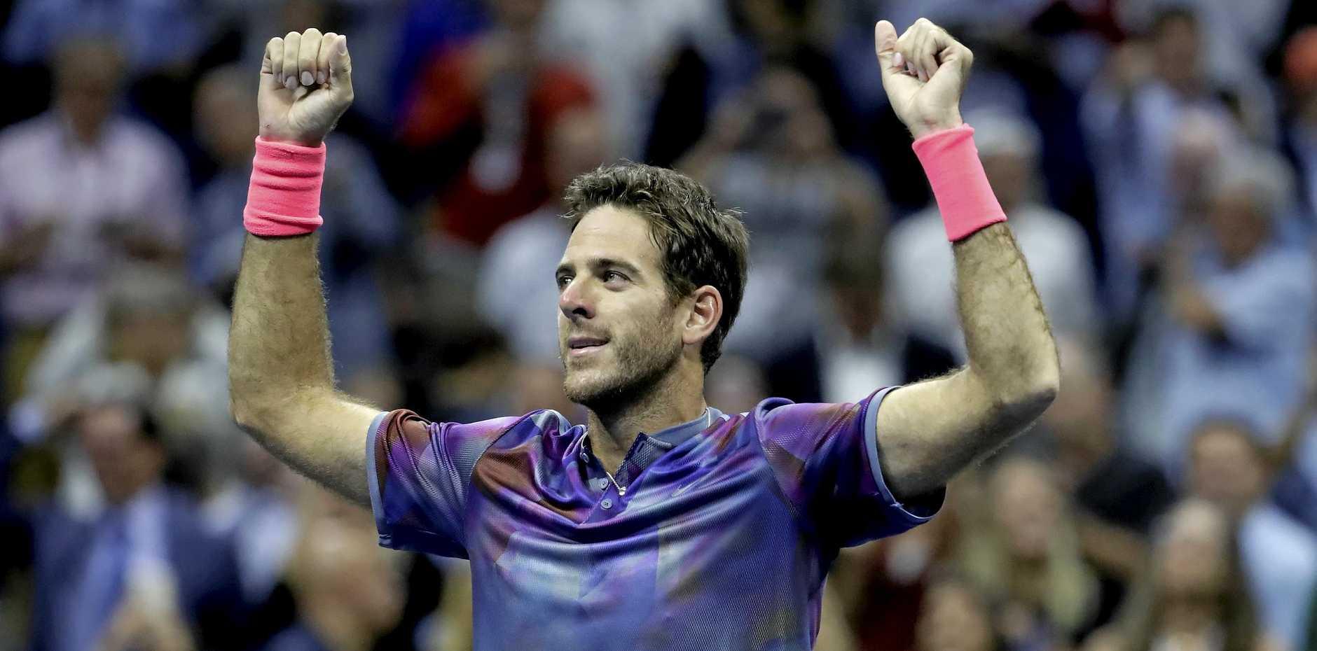 Juan Martin del Potro reacts after defeating Roger Federer.