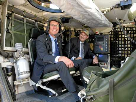 Ipswich Mayor Andrew Antoniolli and Rheinmetall Defence managing director Gary Stewart get up cloae and personal with a Boxer CRV at North Ipswich Reserve on Thursday.