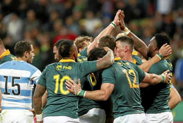 South African players celebrate the try of Siya Kolisi against Argentina last month.
