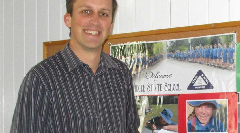 125 YEARS YOUNG: Principal Matt Elson has worked cohesively with locals, compiling history with memorabilia for the 125th Anniversary celebrations tomorrow at Widgee State School.