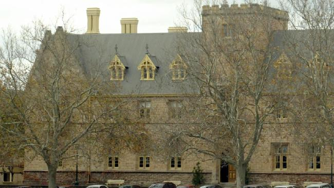 Two students from St Peter's College in Adelaide have been charged with filming and distributing 'humiliating' material.