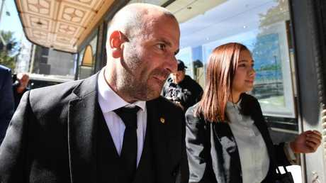George Calombaris arrives at the Downing Centre court in Sydney.