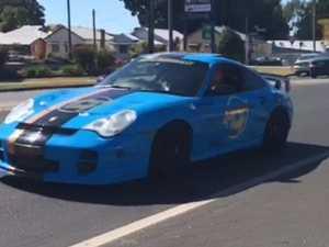 Rally cars pass through Grafton