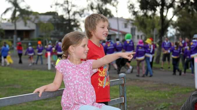 ALL SMILES: Two children watching the Dalby Relay for Life last year.