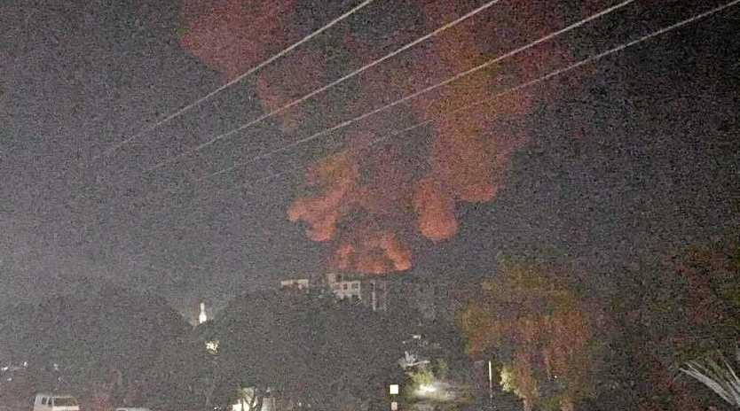 COAST BLAZE: Massive clouds of smoke and a red glow could be seen in the sky.
