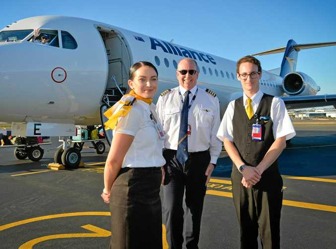FLYING HIGH: Operating Crew on Alliance Airlines flight from Brisbane, Captain Jeffery Bradley, cabin manager Chloe Murphy, first officer Cameron Stonye and flight attendant Dion Sharman