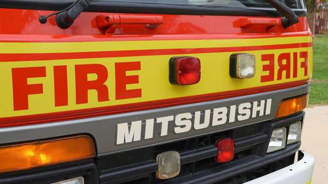 A Bundaberg firefighter noticed flames coming from a bin at a business on Tantitha St neighbouring the the station.