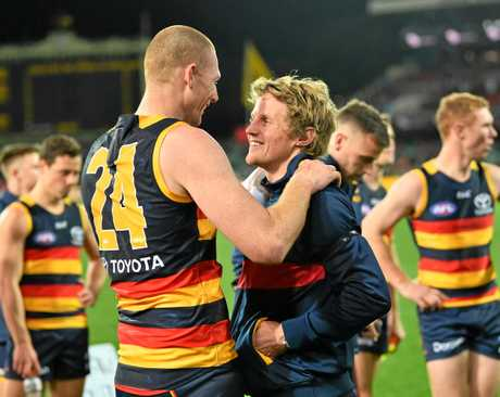 Rory Sloane of the Crows with Sam Jacobs.