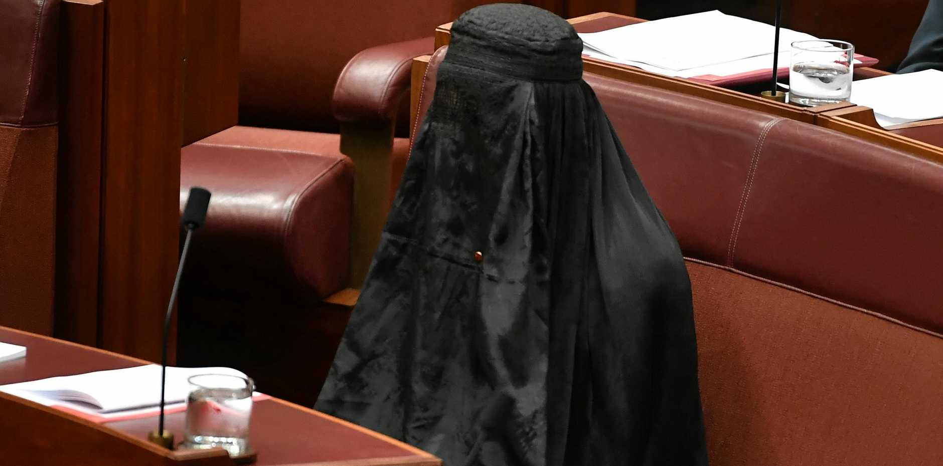 One Nation Leader Senator Pauline Hanson wears an Islamic veil in the Senate chamber at Parliament House in Canberra, Thursday, August 17, 2017. (AAP Image/Mick Tsikas) NO ARCHIVING