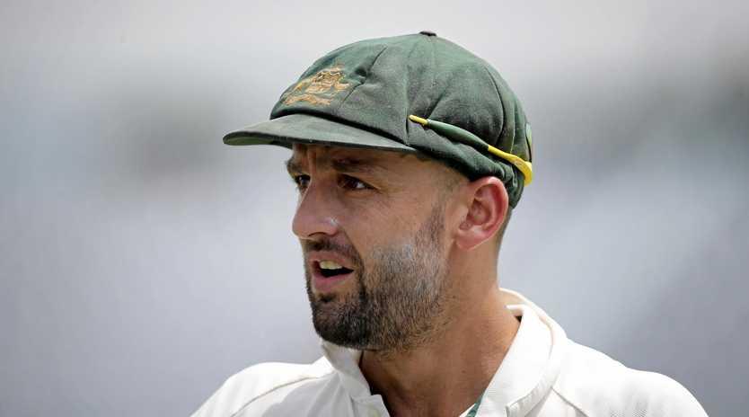 Australia's Nathan Lyon looks on as he fields against Bangladesh.