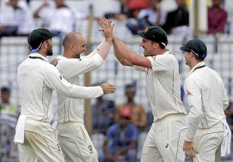 Australia's Nathan Lyon celebrates with his teammates after the dismissal of Bangladesh's Mominul Haque.
