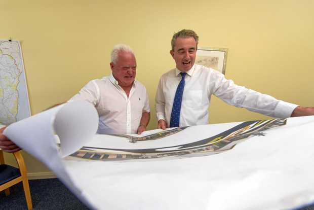 CEO of Signature Care Graham Croft looks over plans of previously built aged care homes with Member for Page Kevin Hogan.