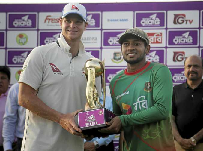 Australian captain Steve Smith and Bangladeshi captain Mushfiqur Rahim hold the tournament trophy after their second Test.