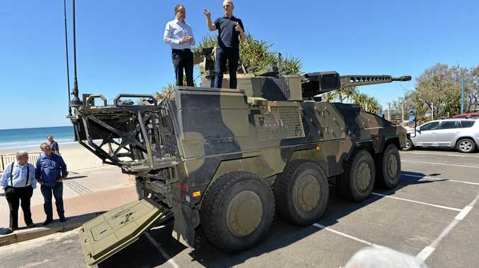 Member for Fairfax Ted O'Brien (left) and Rheinmetall Defence head of sales Simon Coburn spruik the features of a Boxer combat reconnaissance vehicle in the Maroochydore Surf Club car park.