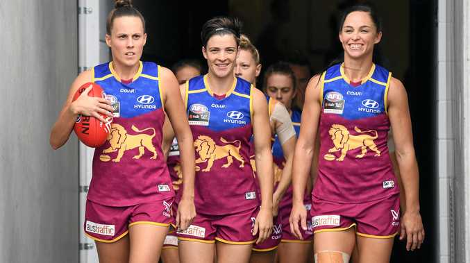 Brisbane Lions captain Emma Zielke (left) leads her team on to the field for the AFLW grand final in March.