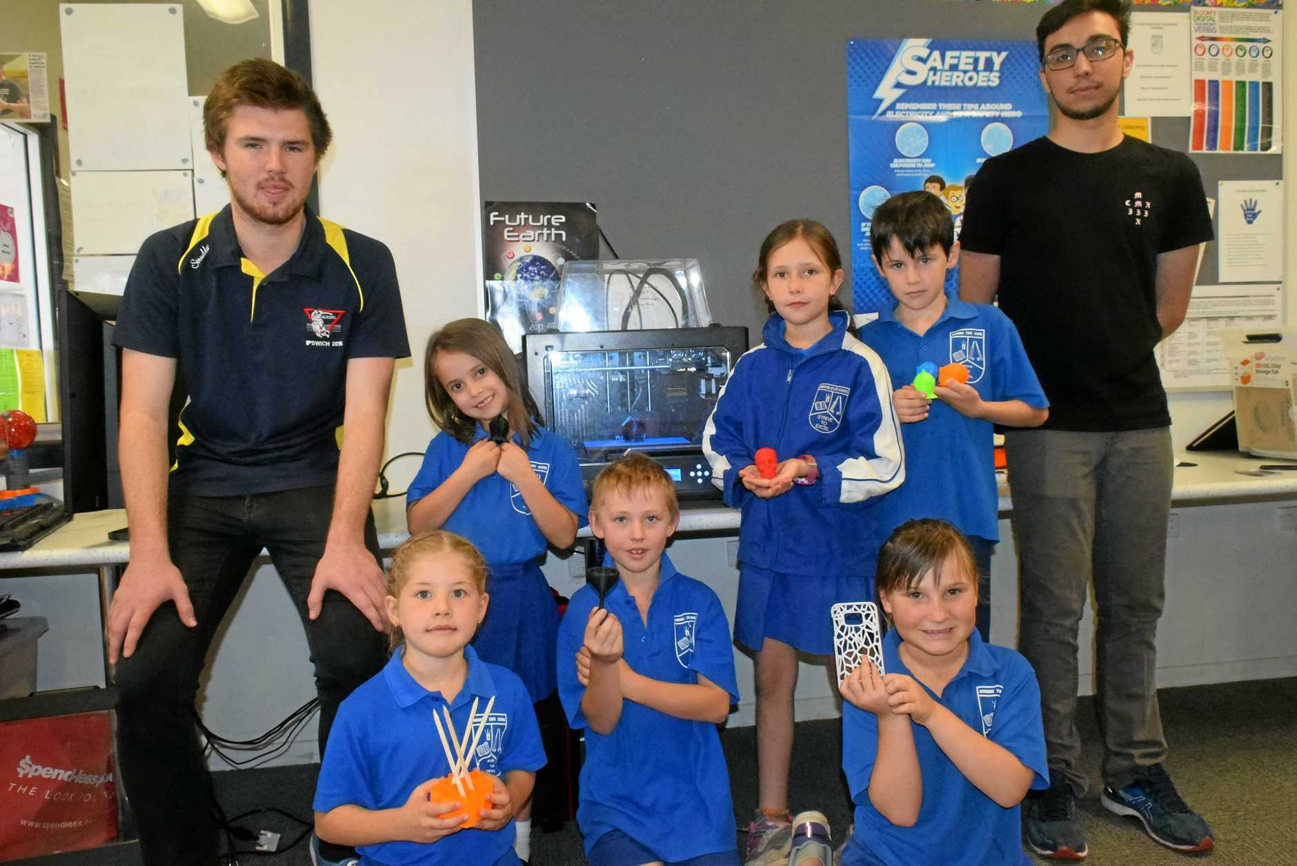 BACK ROW: ABA 3D Printing Solutions co-founders Ben Emerick and Alex Fleming with Ambrose State School students Katie-Maree Grahame, 7, Zoe King, 9, Riley Zeimer, 9. Front row: Students Kaitlyn Smith, 7, Declan Newton, 8, Harmony, 7.