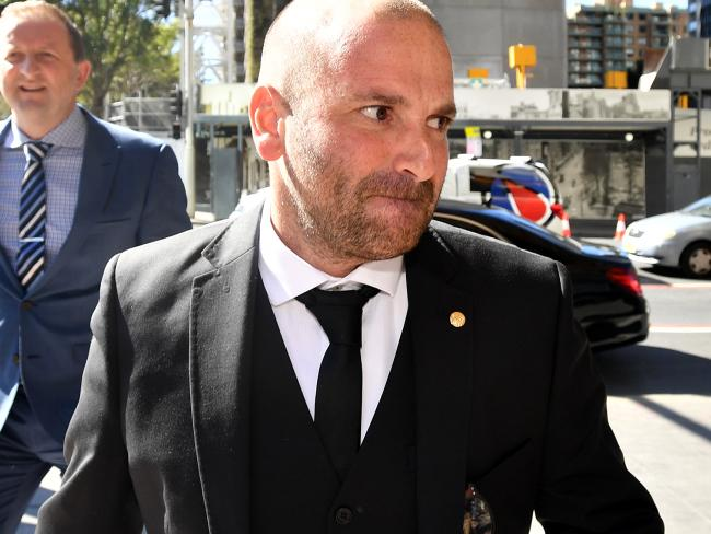 MasterChef judge George Calombaris arrives at the Downing Centre court today. Picture: AAP Image/Joel Carrett