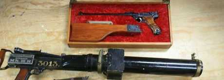 The elderly woman handed in these firearms during the gun amnesty. Picture: Jamie HansonSource:News Corp Australia
