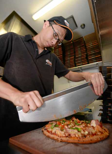Pizza Capers Vincent Chen with the new Teriyaki Pizza.