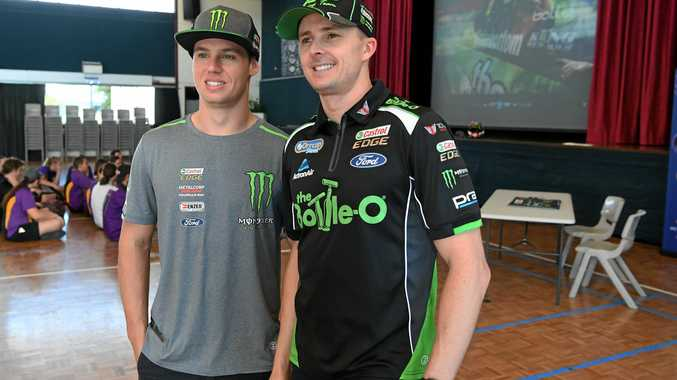 SUPER VISIT: Supercars drivers Cameron Waters and Mark Winterbottom at Bundaberg North State High School on Thursday.