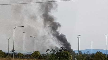 A grass fire burning in Ipswich on Saturday. A reader took this photo standing on Redbank Plains Rd.