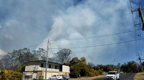 Fire behind properties on Naomi Street in Bundamba on Sunday.