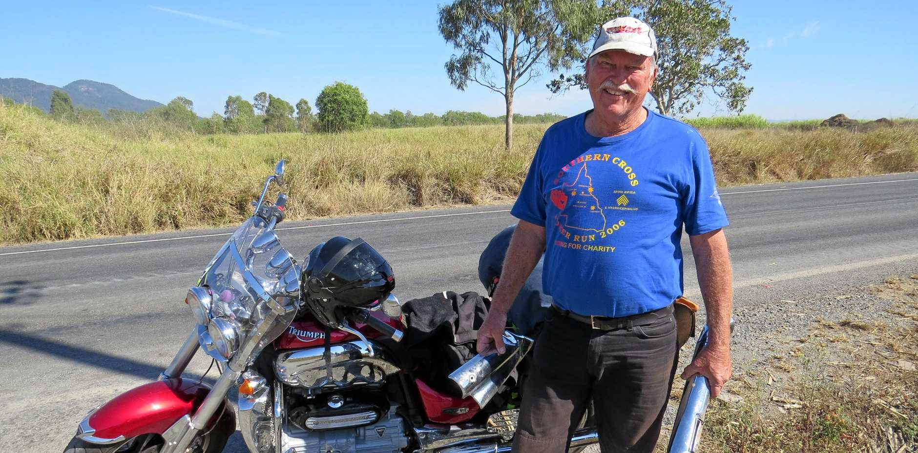 RIDEABLE: Boyd Rayner from Roma with his Triumph Rocket III, holding the exhaust pipe which was torn off in an accident.