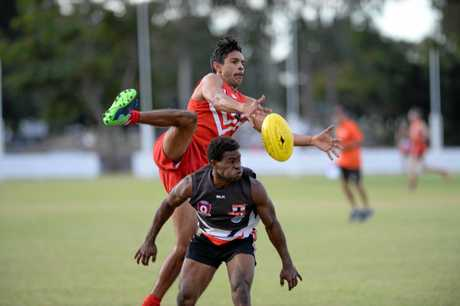 Yeppoon's Grant Van Rooyen and BITS player Peter Nuku contest the ball.