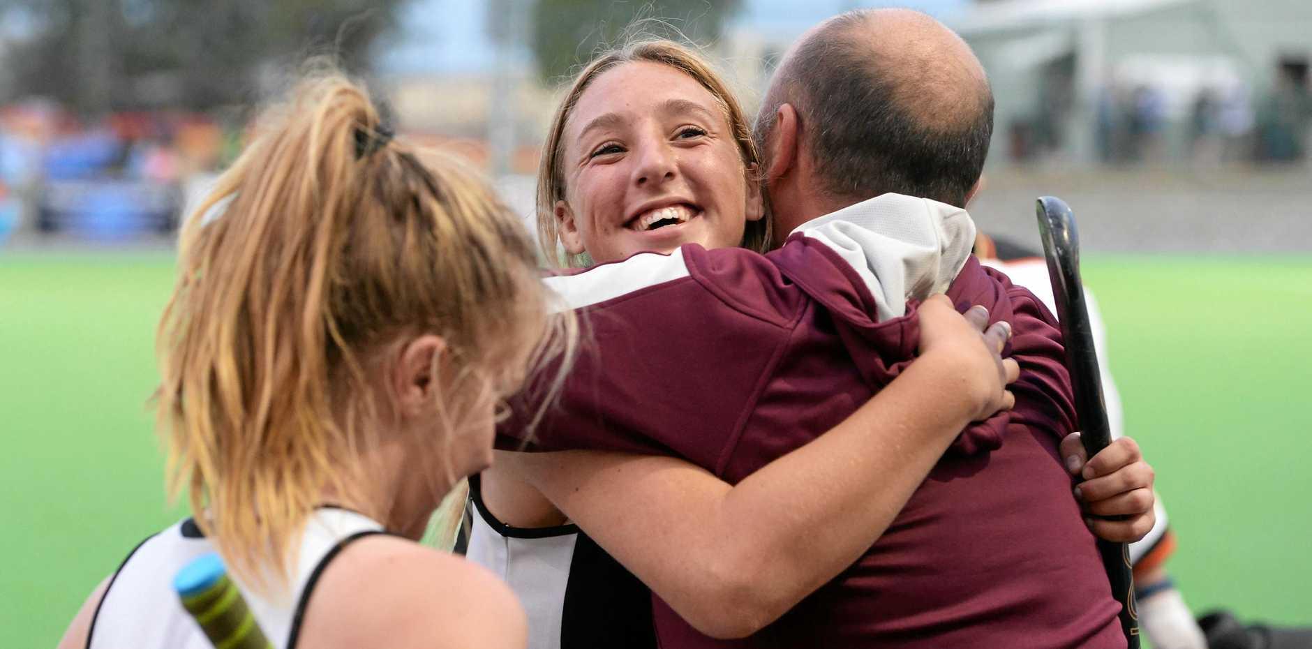 Jess Wilkinson hugs her supportive Wests' coach Brent Nicholls.