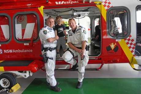 Lismore Police Rescue Unit senior constables Phil Benfield and Brett Green showing youngsters the new Westpac Life Saver Rescue helicopter.