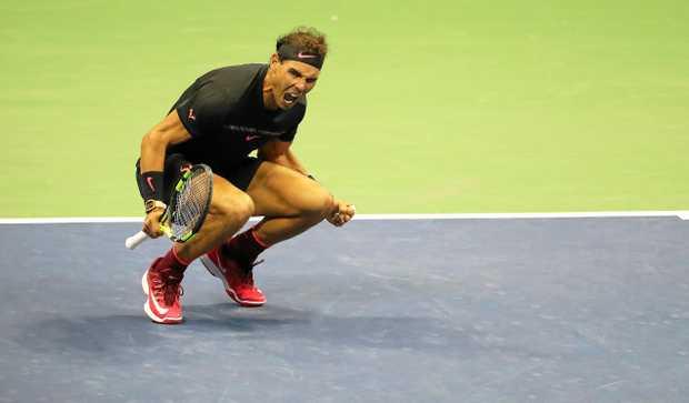 Rafael Nadal reacts after defeating Juan Martin del Potro