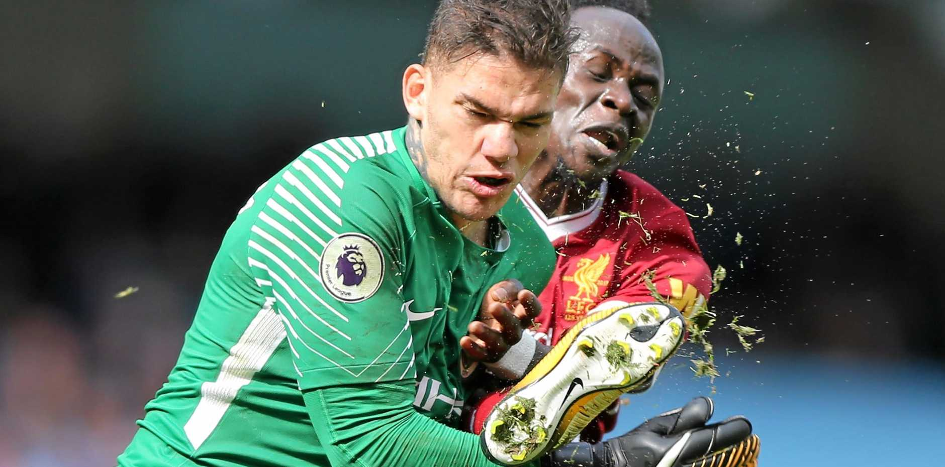 Manchester City's goalkeeper Ederson Santana de Moraes gets a boot in the face from Liverpool's Sadio Mane.