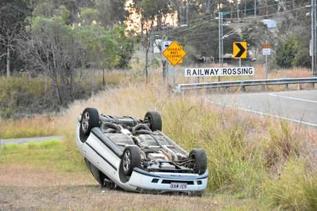 FLIPPED OUT: A car flipped and rolled in a crash at the railway crossing at Awoonga Dam Rd, Benaraby.