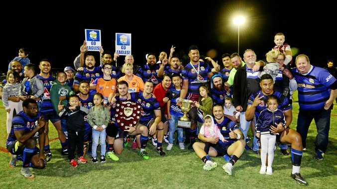 WINNERS: The Goodna Eagles, and friends, celebrate their A Grade premiership win. Coach Laurie Campbell insists the club can dominate the competition long term.