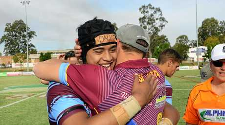 WELL DONE: West End coach Jae Woodward hugs Lisite Hafoka after the big prop did himself, his family and his club proud.