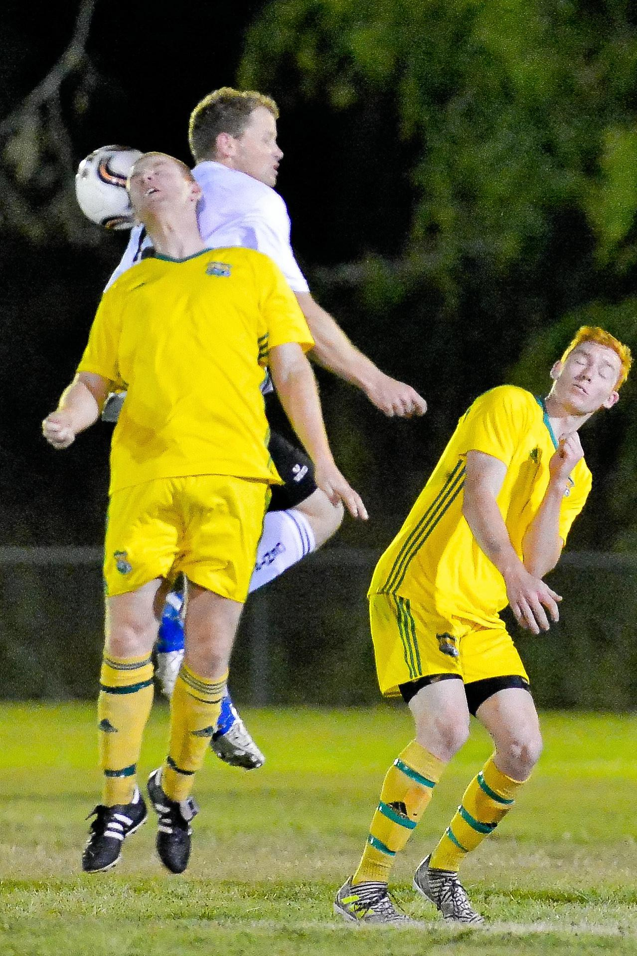 HEADS UP: BITS' Dominic Stockdale contests a header with teammate Luke Kenney watching on.