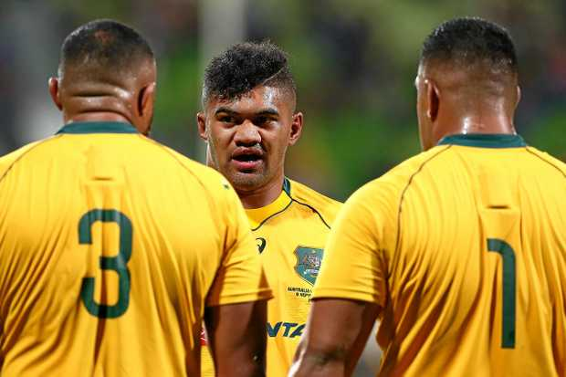 Jordan Uelese (centre) talks with Sekope Kepu and Scott Sio at a break in play during The Rugby Championship match between the Wallabies and the Springboks.
