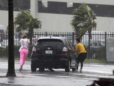 Stranded motorists try to get back in their car after a breakdown as Hurricane Irma bears down on the Florida Keys. (AP Photo/Alan Diaz)