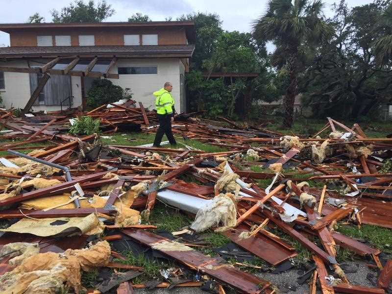 Debris from a second story roof is scattered over a two-block area after a possible tornado touched down at Palm Bay Point subdivision. (Red Huber/Orlando Sentinel via AP)