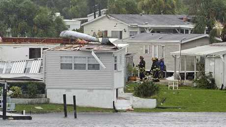 Palm Bay fire fighters go house to house after a possible tornado touched down at Palm Palm Bay Estates as Hurricane Irma made landfall in the state of Florida. (Red Huber/Orlando Sentinel via AP)