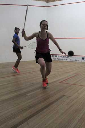 North Coast Women's Open winner Tamika Saxby reaches for a forehand return in the final against Sanayna Kurruville.