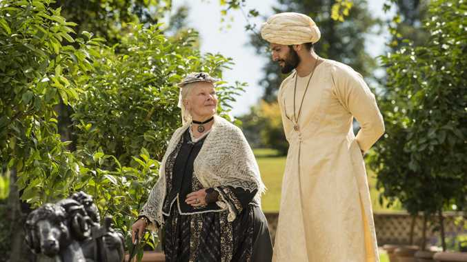 Judi Dench and Ali Fazal in a scene from the movie Victoria and Abdul.