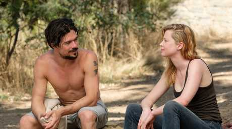 Luke Arnold and Emma Booth in a scene from the season two of Glitch.