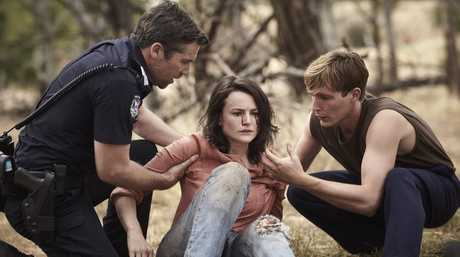 Patrick Brammall, Hannah Monson and Sean Keenan in a scene from season two of Glitch.
