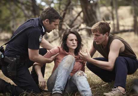 Patrick Brammall, Hannah Monson and Sean Keenan in a scene from season two of Glitch.