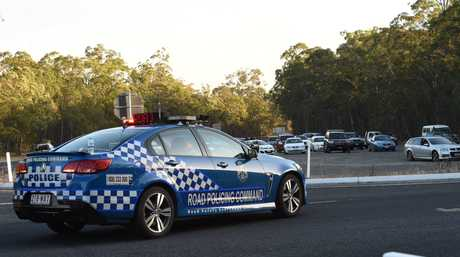 Cars parked near the intersection of Pialba-Burrum Heads Rd and Toogoom are where police have closed the road due to a fire at Burrum Heads.